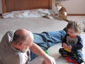 Grandpa and Jaxon playing blocks.