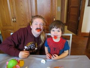 Paulina and Jaxon playing with Potato Head stuff on Christmas morning.