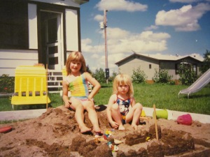Jessica and Victoria in their enlarged sandbox. This was an upgrade from the tractor tire version.