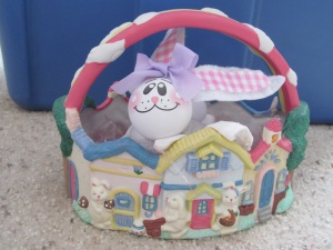 Ceramic Easter basket with bunny made from a glove.
