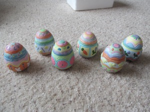 Ceramic Easter eggs with candles inside.