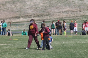 Kathy, Victoria, Jaxon and possibly Carson crossing the field.