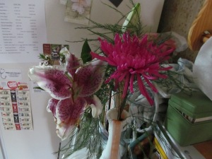 The flower on the right is the spider mum Paulina gave me at graduation. The lily on the left is Jaxon's flower he got at the store.