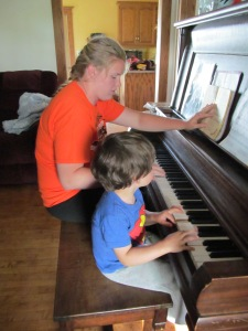 Paulina and Jaxon playing piano.