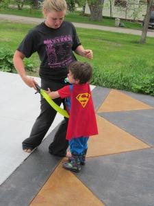 Jaxon with Victoria in his super man cape.