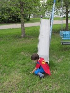 Jaxon sliding down the swing.