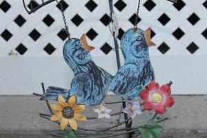 The birds welcome everyone to the garden.