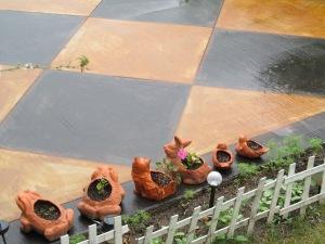 Terracotta animal pots enjoying the rain.