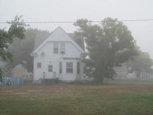 MyMom's house shrouded in mist.