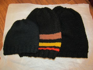 Three finished beanie caps.
