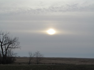 Sun almost through the clouds.