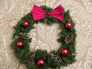 I think that I made this the same year Paulina did hers. It is made with recycled pinecones and ornaments.