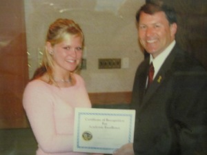 Victoria accepting the outstanding senior student award for her school from Gov. Rounds in Pierre.