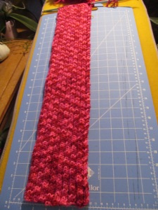 The scarf is two feet long so far.