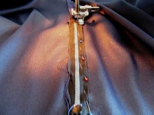 Putting in the zipper.