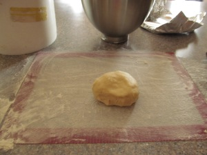 I like to roll it on a mat with flour and a little sugar so it doesn't get too stiff.