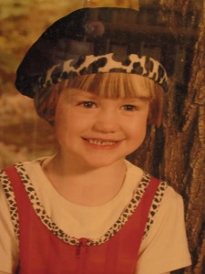 Taken before she was in kindergarten, one of my favorite pictures of her. That smile is still the same, a gritting of the teeth.