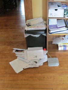 Papers to be shredded after cleaning out financial files and other junk.