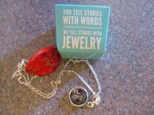 The red thing is to hold the necklace and the other is what it came in.