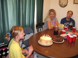 Elisabeth is a few years older than this birthday. Adie and Steve in the background.