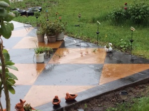 Rain on the concrete.