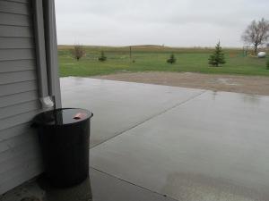 Rain barrel is flowing over.