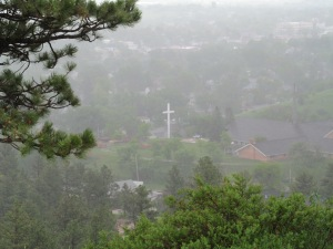 The church is just to the right of that cross as you can see through the mist.