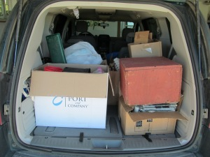 Van full of items to drop at recycling place.