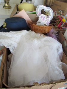 Looks like a box of dressing up clothes to me. I seriously think this may have been her wedding stuff.