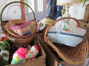 I was actually excited about picking up these baskets. I think the bottom one on the far right would be great for flower cuttings or cuttings of dill from the garden. The bottom one on the right has beautiful decorations on the side. I am too lazy to walk downstairs to get a better shot of them now, but perhaps next week sometime. Again I am thinking garden work for it.