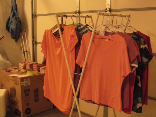 The orange shirt on the left was the first item to go. Paulina's items were on the left, and that is the only side that sold.