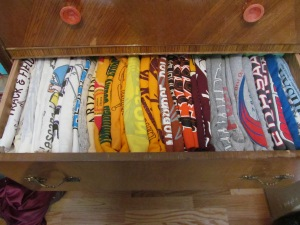 T-shirts in line by color.