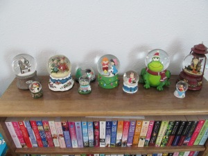 Snow globes and top row of bookshelf.