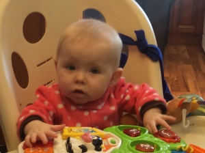 Ana in her high chair waiting for food. She loves eating.
