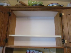 Cupboard empty, shelves cleaned and readjusted.
