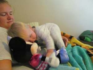 Cuddling with Paulina and holding the Minnie from Grandma