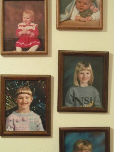 Jessica's early pictures on the wall going down the steps at home.