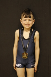 Jaxon with his medal.