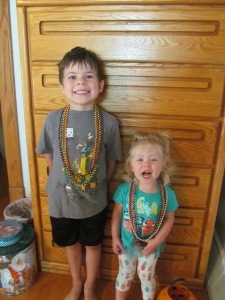 Jaxon and Ana showing off their beads