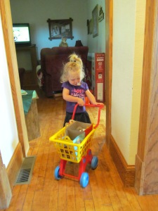 Playing with Jessica's shopping cart on Thursday.