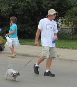 James walking Raja at the parade in Jamestown this summer.