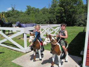 Ana and Jaxon on the ponies