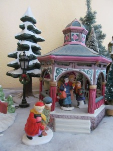 Shoppers near the Christmas Village gazebo.