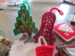 Plastic canvass and crocheted items.
